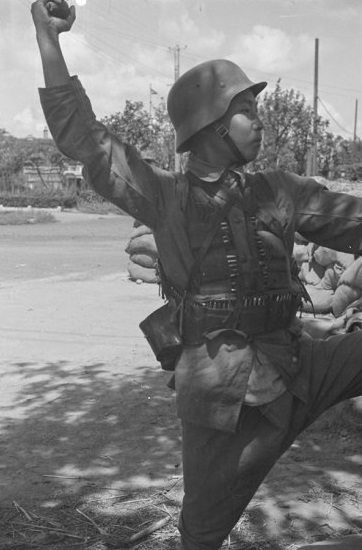 Nationalist soldier, with hand grenade